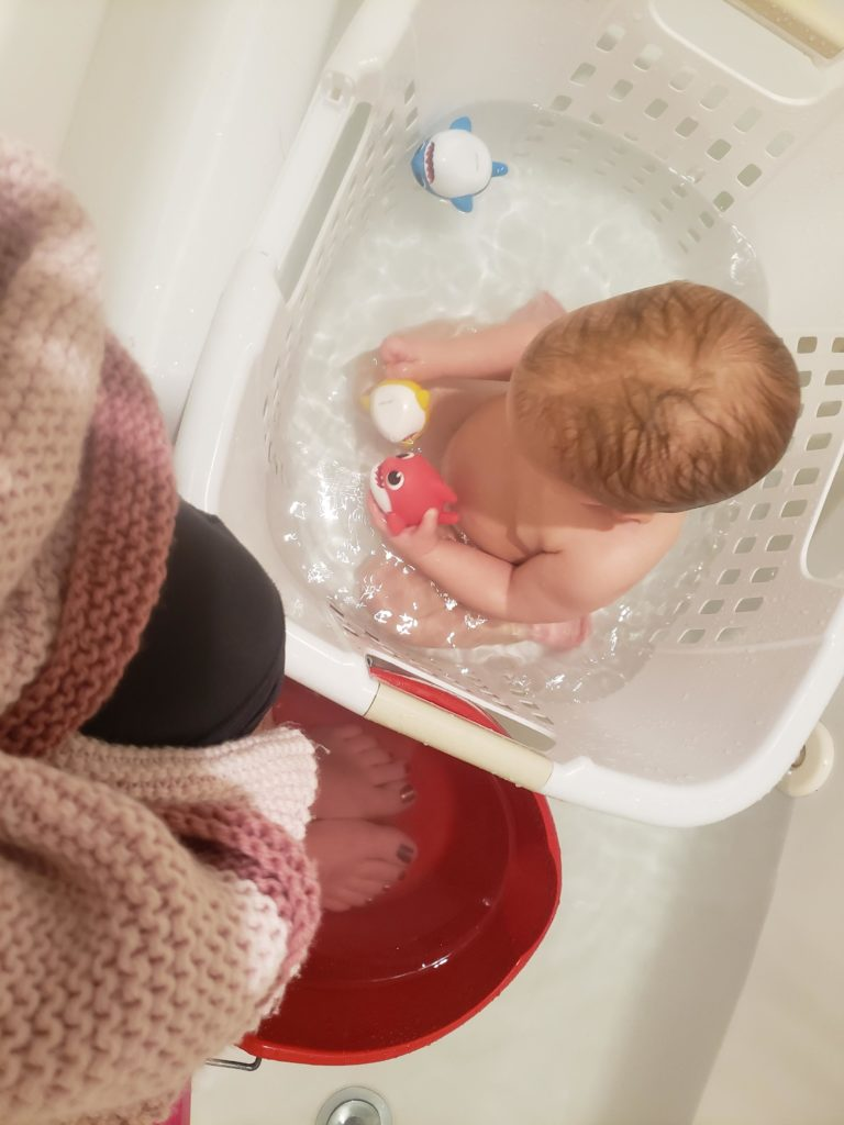 Parenting Hack: Bath For Baby (In A Laundry Basket) And A Foot Soak With Hotter Water And Epsom Salts For Mama In A Bucket!